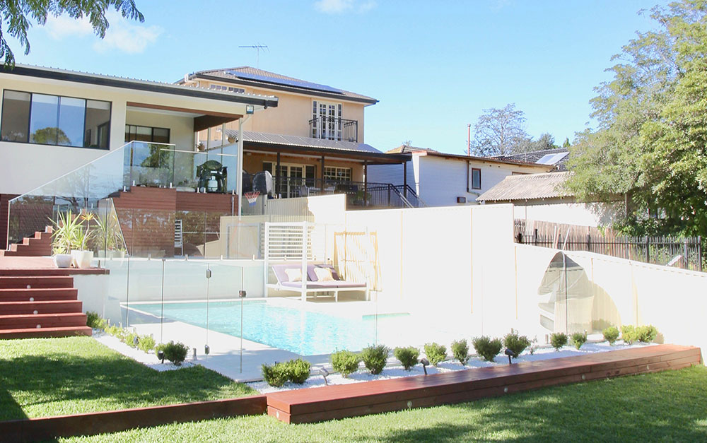 Swimming pool in front of property built by Blue Haven Pools in Padstow Heights Sydney